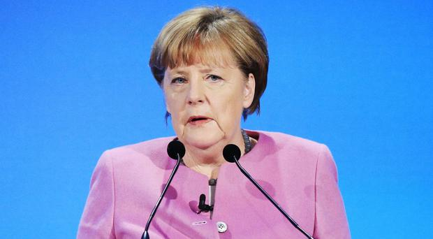 German chancellor Angela Merkel condemned the mob who screamed at a busload of migrants