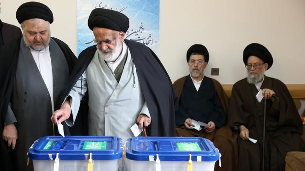 Iranian clergymen vote in the parliamentary and Experts Assembly elections at a polling station in Qom (AP)