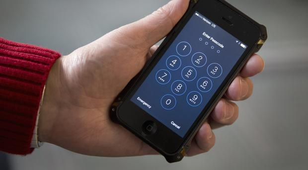 The US government is trying to force Apple to help the FBI hack into a shooter's locked iPhone (AP)