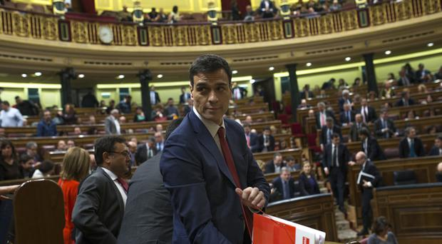 Spain's Socialist leader Pedro Sanchez leaves the main chamber after an investiture voting session at the Spanish parliament in Madrid (AP)