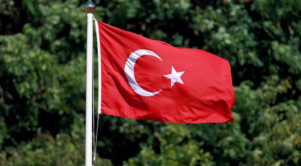 Two women have been shot dead after an attack on a police station in Istanbul, Turkey