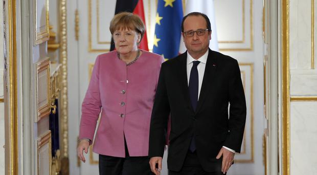 Angela Merkel and Francois Hollande after a meeting at the Elysee Palace in Paris (AP)