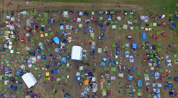 Tents of refugees and migrants stand next to a refugee camp (AP)