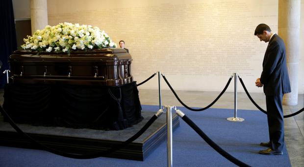 House Speaker Paul Ryan stands near the casket of Nancy Reagan at the Ronald Reagan Presidential Library in Simi Valley, California yesterday