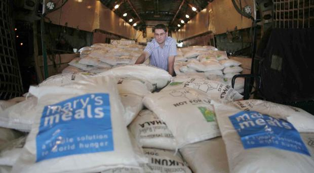 An aid worker with Scots charity Mary's Meals delivers food to the Somalian capital Mogadishu