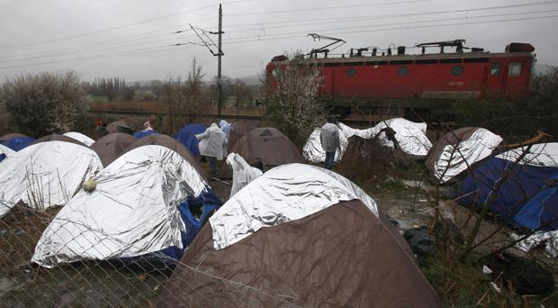 An improvised refugee camp on the border line between Macedonia and Serbia (AP)