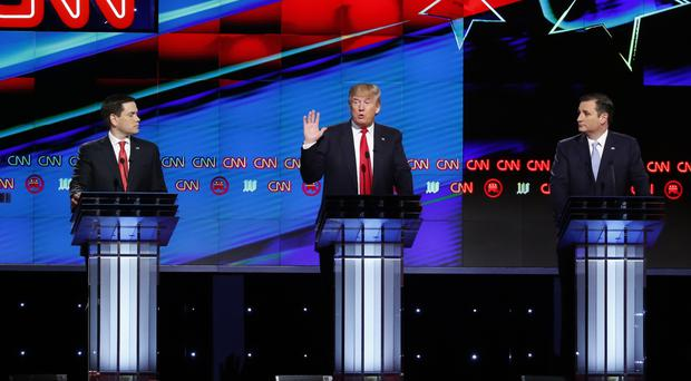 Left to right, Marco Rubio, Donald Trump and Ted Cruz have a relatively polite Republican debate in Miami (AP)
