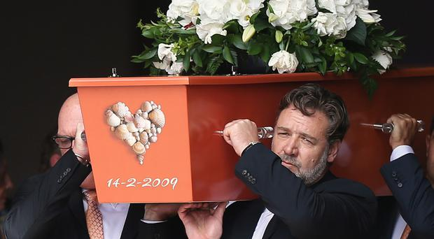 Russell Crowe helps carry the coffin of his cousin Martin (New Zealand Herald/AP)