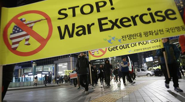 South Korean protesters hold a rally opposing the joint military exercises between the US and Seoul (AP)
