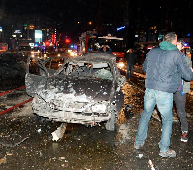 The wreckage of a car after the blast in Ankara. Photo: Defne Karadeniz/Getty Images