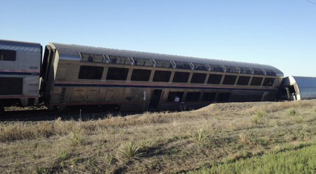 Cars from an Amtrak passenger train on their side near Cimarron, Kansas (AP)