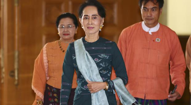 Aung San Suu Kyi arrives in parliament in Naypyitaw (AP)