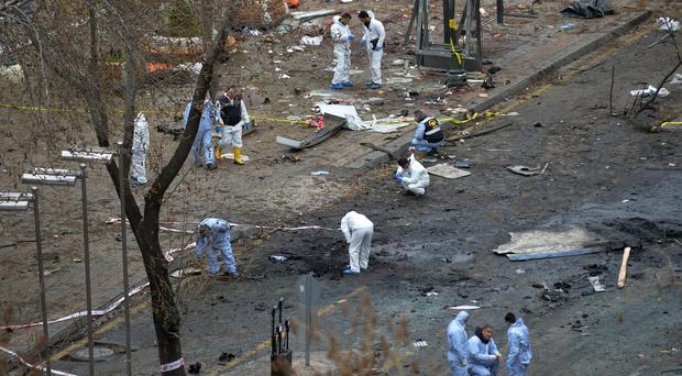 Police forensic officials work at site of a suicide bomb in Ankara, Turkey (AP)