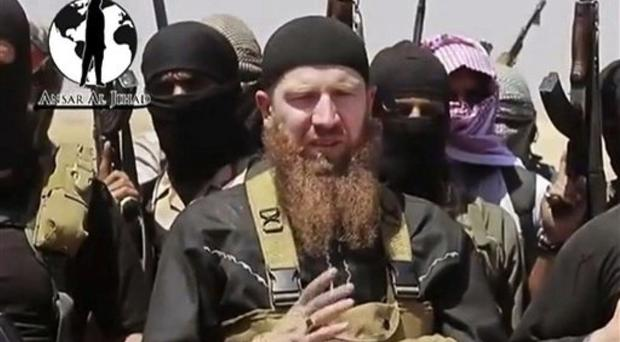 Omar Shishani standing among a group of fighters (AP/militant social media account)