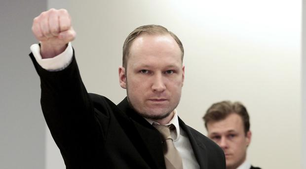Anders Behring Breivik gestures as he arrives at court in Oslo, Norway (AP)