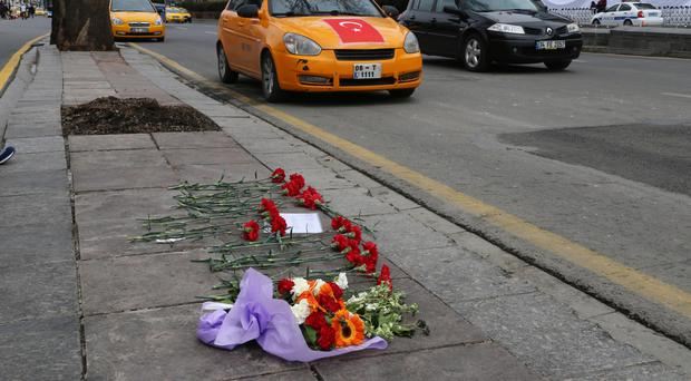Flowers left by local people at the site of a suicide bomb attack in Ankara, Turkey (AP)