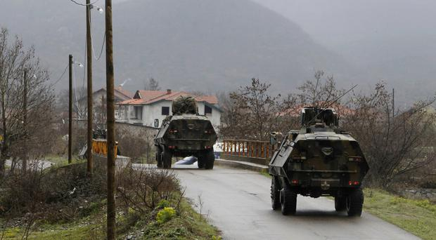 Macedonian Army vehicles patrol the border with Greece (AP)