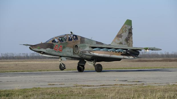 A Russian Su-25 ground attack jet lands after returning from Syria (AP)