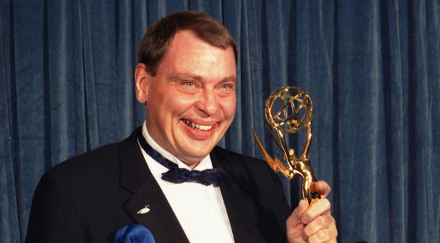 Larry Drake holds the Emmy he won for best supporting actor in a drama series for his role in LA Law (AP)