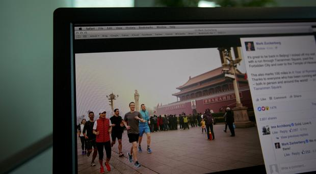 A computer screen displays the social media posting by Mark Zuckerberg on Facebook in Beijing (AP)