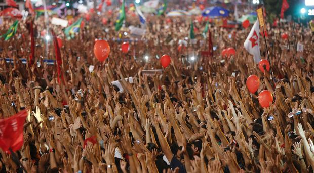 Demonstrators attend a rally in in Sao Paulo (AP)