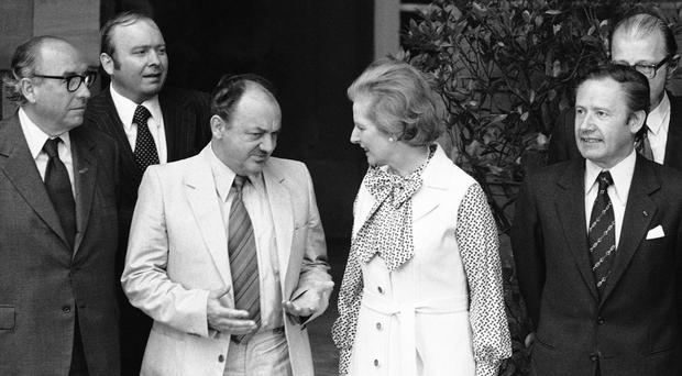 UK prime minister Margaret Thatcher exchanges views with Danish premier Anker Joergensen after a summit meeting at City Hall in Strasbourg, France (AP)