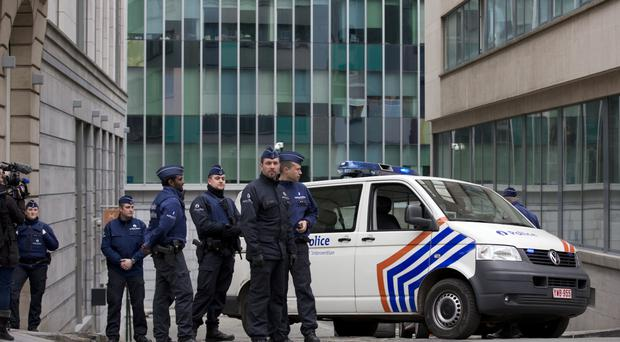 Security forces guard a street leading to the federal police headquarters where captured suspect Salah Abdeslam appeared before a judge in Brussels (AP)