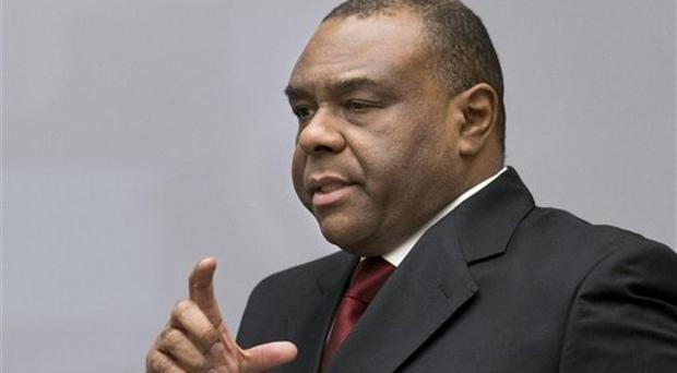 Jean-Pierre Bemba enters the court room of the International Criminal Court in The Hague, Netherlands (AP)