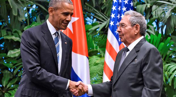 Obama shaking hands with President Raul Castro
