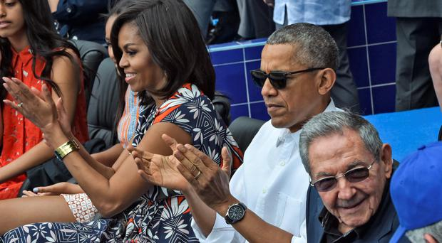 Michelle and Barack Obama with Cuban President Raul Castro at the baseball game between the Tampa Bay Rays and the Cuban national team