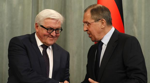 German foreign minister Frank-Walter Steinmeier, left, shakes hands with his Russian counterpart Sergey Lavrov during a news conference in Moscow (AP)