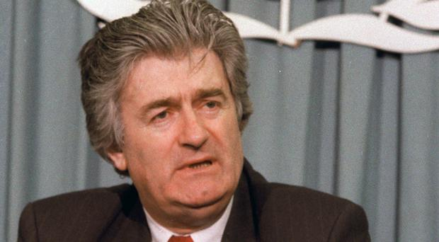 Bosnian Serb leader Radovan Karadzic talks to reporters at United Nations headquarters in March 1993. UN judges are due to deliver verdicts in his genocide and war crimes trial (AP)