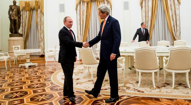 Secretary of State John Kerry shakes hands with Russian president Vladimir Putin before their meeting at the Kremlin in Moscow, Russia (AP)