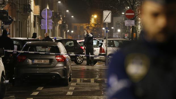 Police set up a checkpoint during a raid in the Brussels suburb of Schaerbeek (AP)