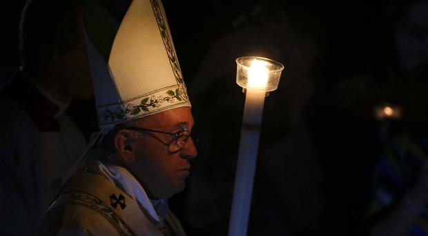 Pope Francis arrives for an Easter vigil service in St Peter's Basilica (AP)