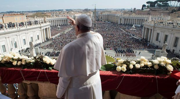 Pope Francis waving to the crowd from St Peter's Basilica during the 'Urbi et Orbi' Easter blessing yesterday
