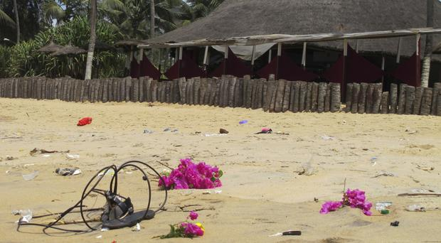 Flowers are laid on a beach where the attack took place in Grand Bassam, Ivory Coast