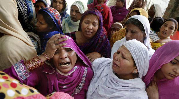 Pakistani women mourn the death of a man killed in a bombing attack in Lahore (AP)