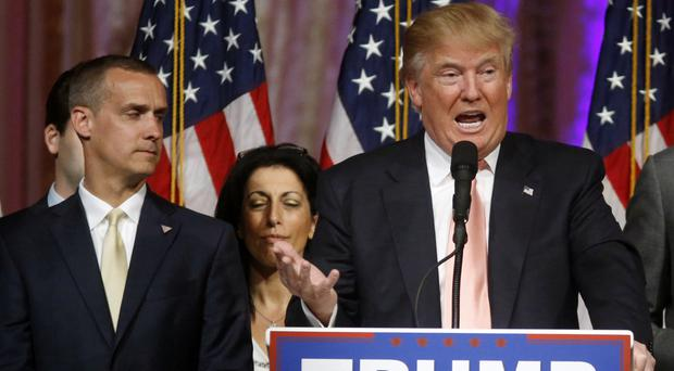 Corey Lewandowski listens as Donald Trump speaks in Palm Beach, Florida (AP)
