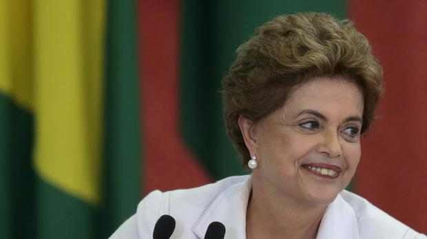 Brazil's president Dilma Rousseff smiles during an event at the Planalto Presidential Palace in Brasilia (AP)