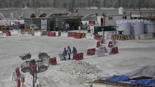 Workers pictured in May last year at the Al-Wakra Stadium that is under construction for the 2022 World Cup in Qatar (AP)