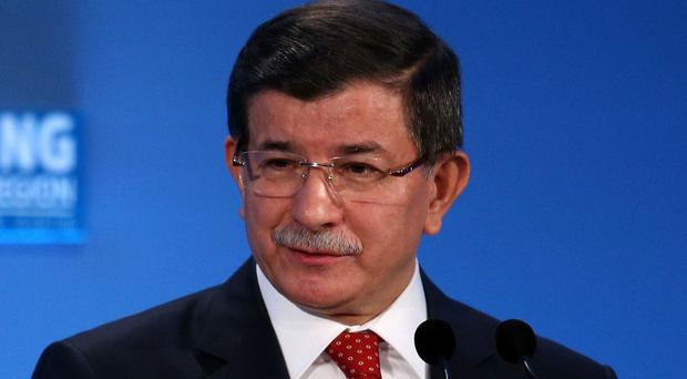 Turkish Prime Minister Ahmet Davutoglu said the migrant deal with the EU would come into effect on Monday