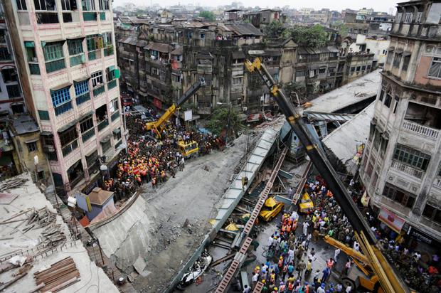 Rescue workers clear the rubble of the partially collapsed overpass in Kolkata yesterday