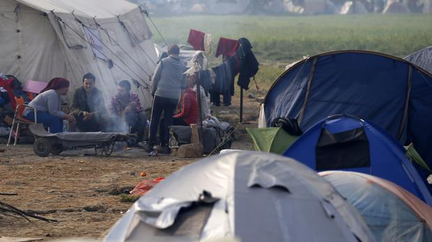 Migrants in a makeshift refugee camp at the northern Greek border point of Idomeni (AP)