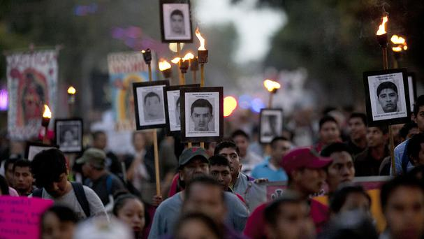 Relatives of the 43 missing students at a protest in Mexico City on December 26 (AP)