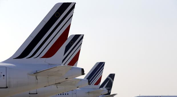 Air France is to allow female flight attendants to refuse to work the company's new route to Iran, for which they must wear a headscarf (AP)