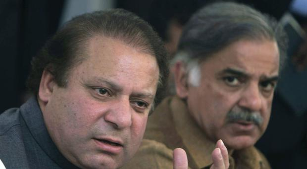 Pakistan's Prime Minister Nawaz Sharif, left, addresses a news conference in Lahore (AP)