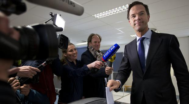 Dutch prime minister Mark Rutte casts his vote in a non-binding referendum on the EU-Ukraine association agreement in The Hague, Netherlands (AP)