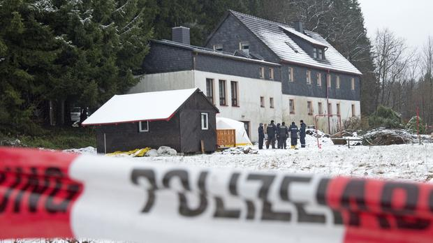 Police investigate the area of crime around a house near Reichenau, south of Dresden (AP)
