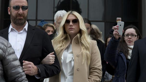 A New York judge has thrown out Kesha's hate-crime and human-rights claims against her former producer Dr Luke (AP)